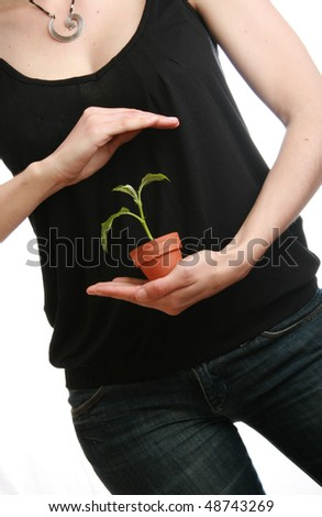 woman holding plant on white background