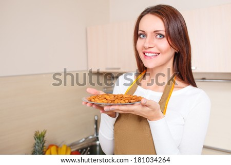 woman holding plate with healthy foods - stock photo