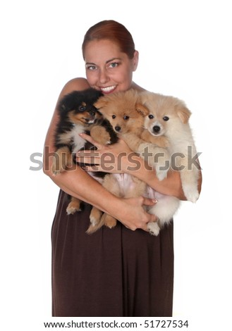 Woman Holding 3 Pomeranian Puppies on White Background