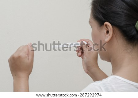 Woman Holding Pregnancy Test.