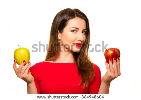 Woman Holding Red and Green Apple Fruit Smiling Isolated on Background - stock photo