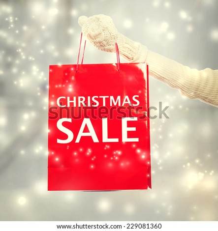 Woman holding red Christmas Sale shopping bag  - stock photo