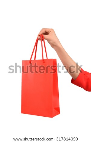 Woman holding red gift bags on white isolated background