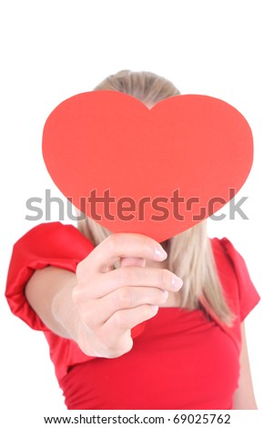 Woman holding red heart card