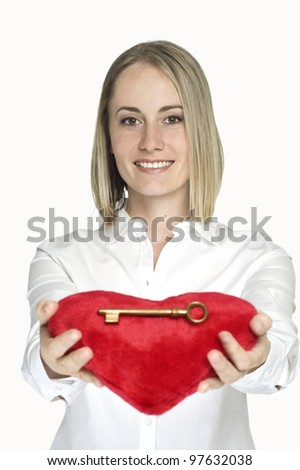 Woman holding red heart with gold key on it