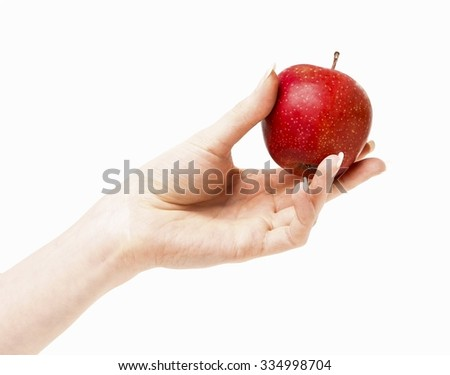 Woman holding red ripe apple in beautiful hand