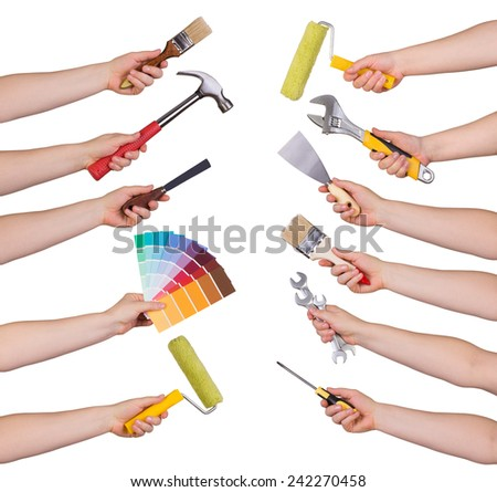 Woman holding redecorating tools isolated on white  - stock photo