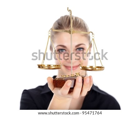 Woman holding scale of justice - stock photo