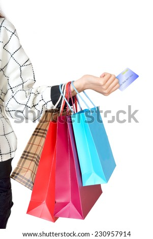Woman holding shopping bags and credit cards - stock photo