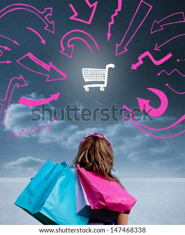 Woman holding shopping bags and looking at a drawing of a shopping cart with pink arrows