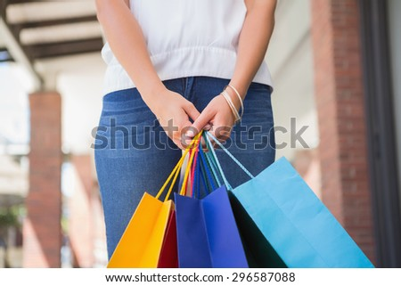 Woman holding shopping bags at a boutique