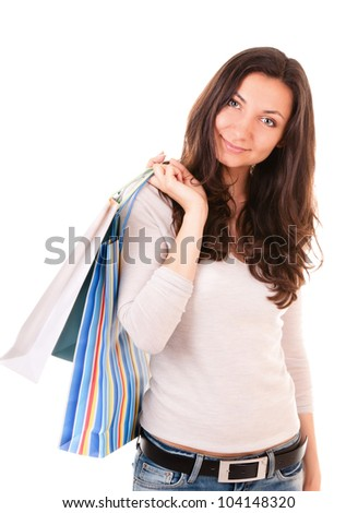 Woman holding shopping bags on white background - stock photo