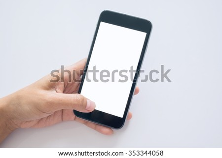 Woman holding smart phone or mobile phone with blank mobile.or on-line shopping.selective focus.or on-line shopping.selective focus.Vintage tone retro filter effect, soft focus.    - stock photo