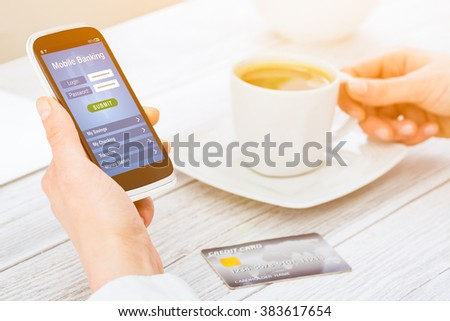 Woman holding smart phone with mobile banking application on a screen. - stock photo