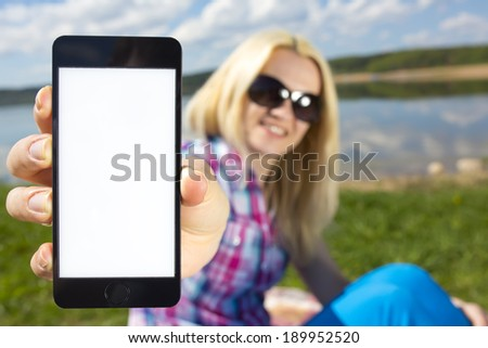 woman holding smartphone in hand - stock photo