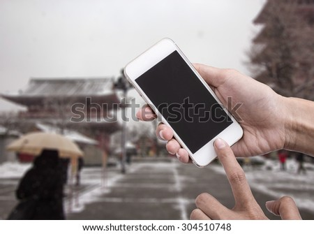 Woman holding smartphone  or mobile phone with blank mobile.Shallow depth of field. - stock photo