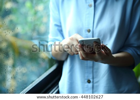 Woman holding smartphone with touch on screen