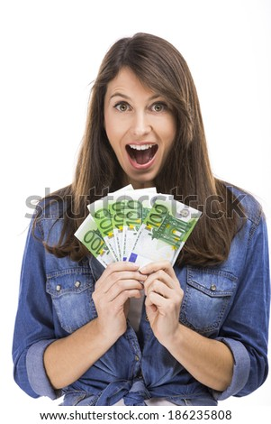 Woman holding some Euro currency notes - stock photo