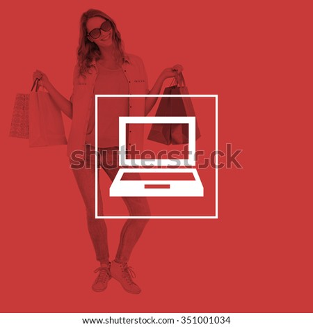 Woman holding some shopping bags against laptop - stock photo