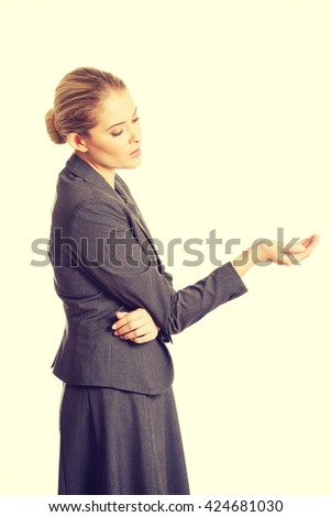 Woman holding something on her hand - stock photo