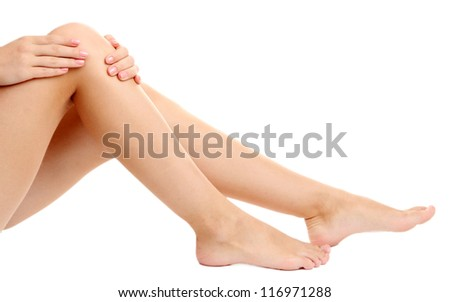 woman holding sore knee, isolated on white