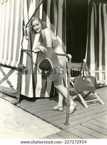Woman holding sun hat - stock photo
