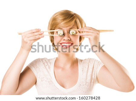 woman holding sushi rolls on her eyes