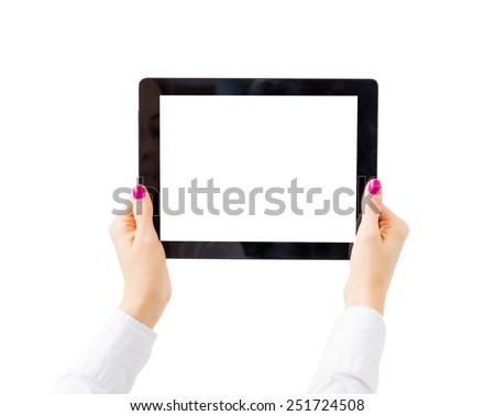 Woman holding tablet computer horizontally - stock photo