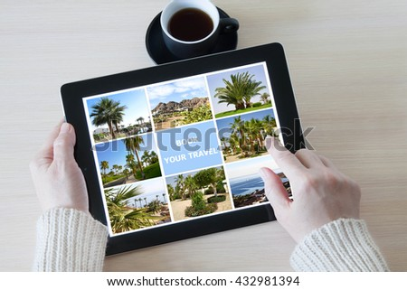 Woman holding tablet computer with traveling pictures gallery, planning vacations, booking trip - stock photo