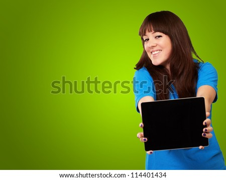 Woman Holding Tablet Isolated On Green Background - stock photo