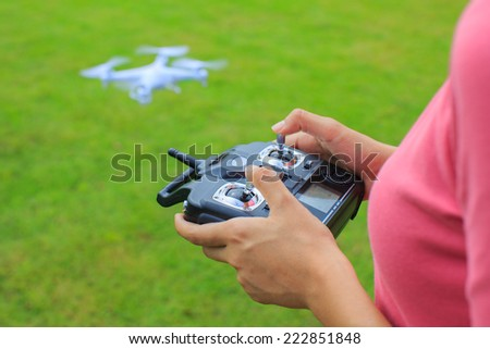 Woman Holding Transmitter for a RC helicopter - stock photo