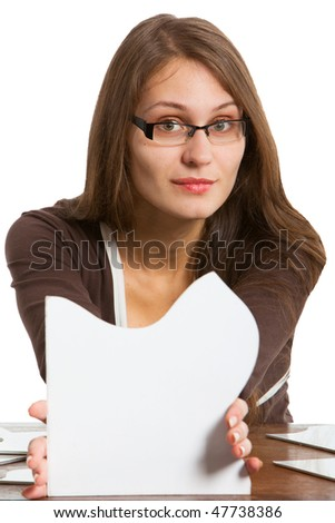 woman holding two big white puzzle card in front of her