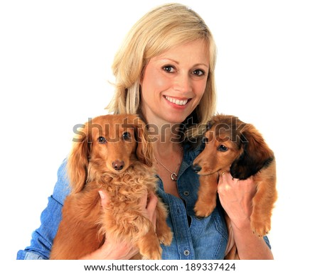 Woman holding two dachshund dogs.  - stock photo