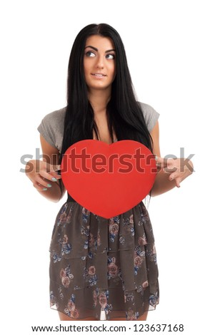 Woman holding Valentines Day heart sign - stock photo