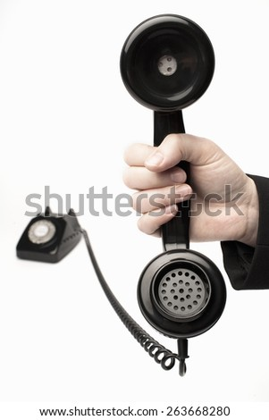 woman holding vintage telephone receiver - stock photo