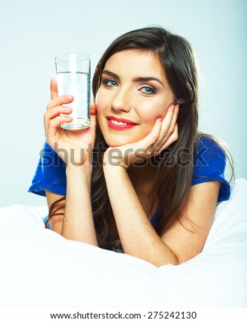 Woman holding water glass. Smiling model.