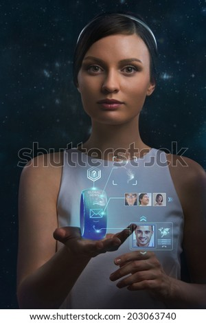 Woman holding wearable gadget. New technologies. Wireless tools. Future communications and social media concept. - stock photo