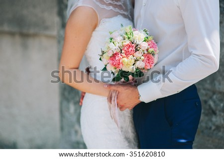Woman holding wedding flowers bouquet