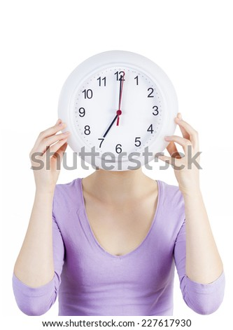 Woman holding white clock covering her face isolated on white background