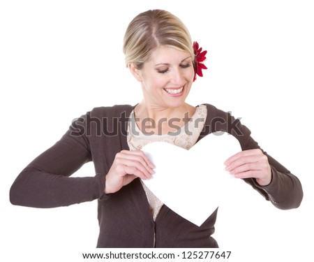 woman holding white heart close-up isolated on white