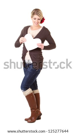 woman holding white heart full length isolated on white - stock photo
