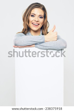 woman holding white sign card. portrait of smiling girl with long hair. studio isolated portrait of female young model. - stock photo