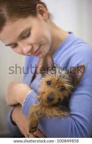 Woman holding Yorkshire Terrier puppy