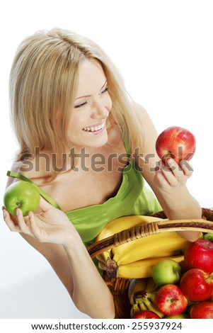 woman holds a basket of fruit on a white background