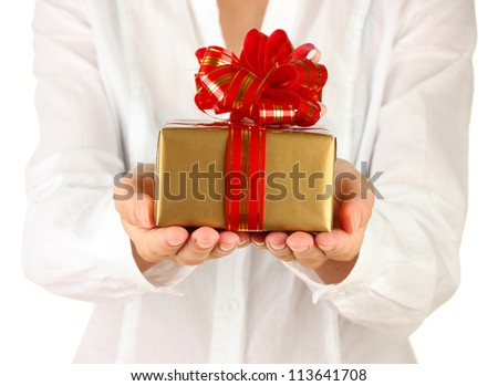 woman holds a box with a gift on white background close-up - stock photo