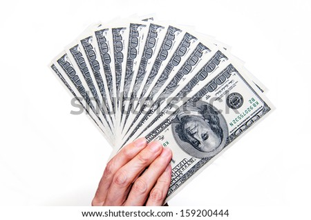 Woman holds a handful of cash on white background - stock photo