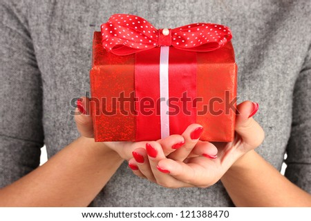woman holds  box with gift on white background close-up - stock photo