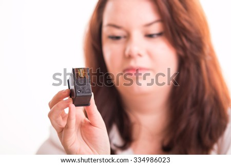 Woman holds printer cartridge - close up