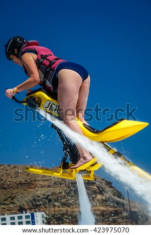 Woman hovering above water on a jet ski in Gran Canaria, Spain. Picture taken in april, 2015. - stock photo