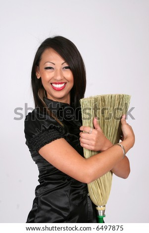 Woman hugging a broom, enjoys housework